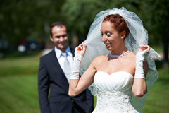 Bride and groom on walk Stock Photography