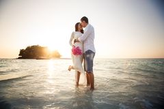 Bride and groom walk barefoot at spit Stock Image