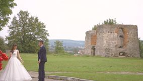 Bride And Groom on the Walk. The Launch Balloons stock video footage