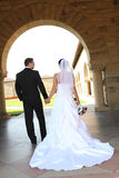 Bride and Groom Walking Stock Image