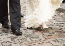 Bride and groom walking Stock Images