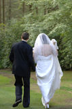 Bride and Groom walking away. From wedding Royalty Free Stock Images