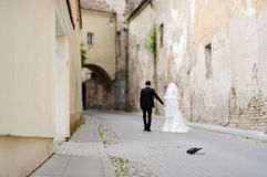 Bride and groom walking away Stock Photos
