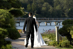 Bride and Groom walking away stock photography