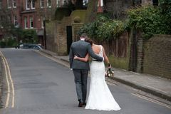 Bride and Groom walking away Royalty Free Stock Images