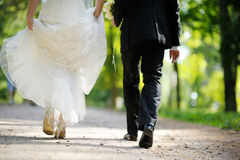 Bride and groom walking away Stock Image