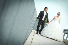 Bride and groom walking in city Stock Images
