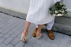 Bride and groom walking on the city Royalty Free Stock Photo