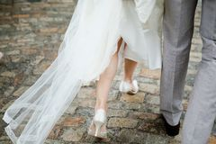 Bride and groom walking, details bride`s on legs royalty free stock photos