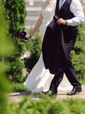 Bride and Groom Walking Fast Royalty Free Stock Photo