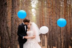 Bride and groom walking forest Royalty Free Stock Photography