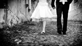Bride & groom walking holding hands Stock Photo