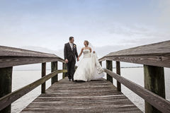 Bride and Groom walking royalty free stock photography