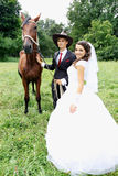 Bride groom walking a horse Stock Images