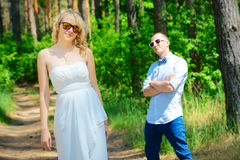 Bride and groom walking in nature summer Stock Photo