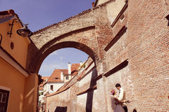 Bride and groom walking in old city Stock Images