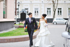Bride and groom walking in an old town Royalty Free Stock Photos