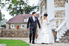 Bride and groom walking in an old town Royalty Free Stock Photo