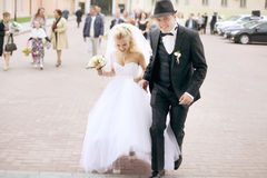 Bride and groom walking Royalty Free Stock Photo