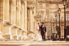 Bride and groom walking in Paris Royalty Free Stock Image