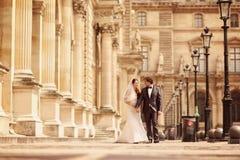 Bride and groom walking in Paris Royalty Free Stock Image