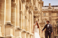 Bride and groom walking in Paris Stock Photography