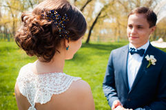 Bride and groom walking at the river Royalty Free Stock Photo