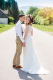 Bride and groom walking on the road. Out of town Royalty Free Stock Photos