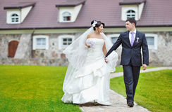 Bride and groom walking together Stock Images