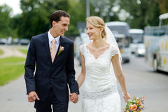 Bride and groom walking together Stock Photos