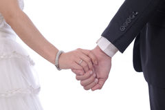 Bride and groom walking together holding their hands Stock Photo