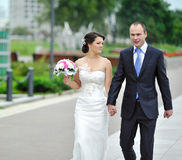 Bride and groom walking together in an old town Royalty Free Stock Photo