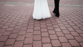 Bride and groom walks in the city stock footage