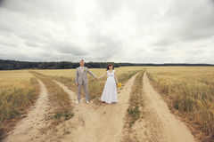 Bride and groom walks at nature Stock Image