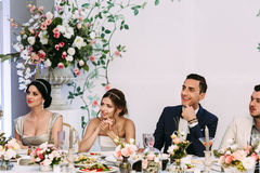 Bride with the groom are watching on the guests Stock Photos
