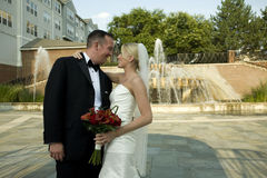Bride and Groom by Water Fountain Stock Photo