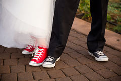 Bride and Groom Wear Converse Stock Image