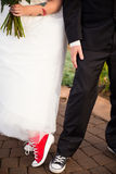 Bride and Groom Wear Converse Stock Photography