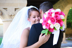 Bride and Groom at Wedding. A beautiful bride and hugging groom at church during wedding stock photo