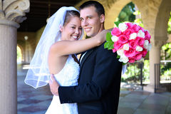 Bride and Groom at Wedding. A beautiful woman bride and handsome man groom at church during wedding royalty free stock photos