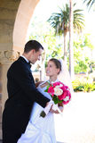 Bride and Groom at Wedding. A beautiful woman bride and handsome man groom at church during wedding stock photo