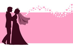 Bride and groom at the wedding background. Couple are embracing on a pink background with hearts Stock Photo