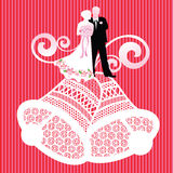 Bride and groom on wedding bells. With embroidery pattern Stock Photo