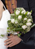 Bride, groom and wedding bouquet Stock Photos