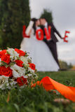 Bride and groom. Wedding bouquet on a background of newlyweds Stock Images