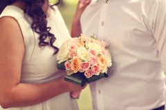 Bride and groom with wedding bouquet Royalty Free Stock Image