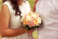 Bride and groom with wedding bouquet Royalty Free Stock Images