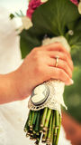 Bride and groom with wedding bouquete. Bride and groom hands with wedding bouquete Royalty Free Stock Photography
