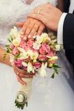 Bride and groom with wedding bouquete. Bride and groom hands with wedding bouquete Royalty Free Stock Image
