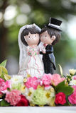 Bride and groom on a wedding cake Royalty Free Stock Images